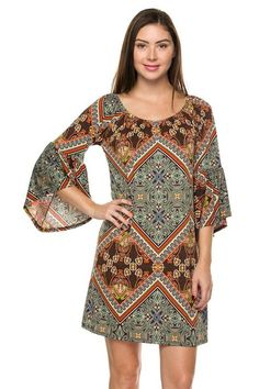 Stunning plus size shift dress! Gorgeous, silky soft and flowy. Fits true to size. Amazing print pattern accented with shades of jade, rust, and chocolate. A definite must have for all. Perfect for any occasion, dressy enough for a wedding or event, but yet casual enough for a daytime date. Bold and beautiful bell sleeves with a round neckline. Made of 92% lightweight (not sheer at all) polyester and 8% spandex for super soft comfort and easy washer/dryer care. A fave!