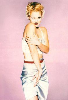 All that skin and shine. Drew Barrymore for Miu-Miu (Prada), Spring 1995.