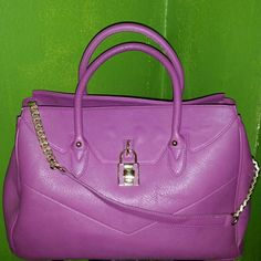 "Just Fab ""Palatial"" Fuschia Handbag Satchel Just Fab Fuschia Palatial handbag.  Features rounded top handles, a front padlock detail, and gold chain link detail shoulder strap. Gently used once, Excellent condition.  No rips, tears, stains or marks.  Beautiful color as pictured ! Material: Faux Leather Size: 15.5L x 10.5H x 6.5D Shoulder drop measurement: 4"" Pockets: 1 interior pocket, 1 interior zip Closure: Zip closure JustFab Bags Satchels"