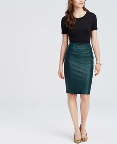 must have --> Crafted in luxe faux leather, our latest pencil skirt is a true A-lister. Hidden back zipper with hook-and-eye closure. Back vent.