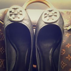 Tory Burch Reva Black Flats Size 8 Barely worn size 8 Reva Flats. These are in great condition but to big around my heel. Fit more like an 8 1/2 than an 8. Gold Tory symbol and black leather. I have the bag but not the box. Tory Burch Shoes Flats & Loafers