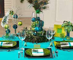 Check out this peacock-themed Christmas table décor by BHG! Get all the peacock feathers needed here: http://www.craftsfeathersfloral.com/home/cff/listitems_685/peacock.html