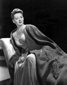 Bette Davis in Now, Voyager (1942). This gown and cape are absolutely gorgeous. She sure cleaned up good. JC
