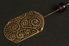 Pendant by Sara Bran. It looks like lace.