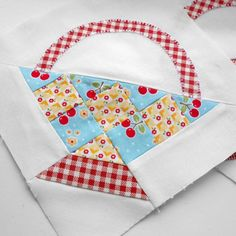 Farmer's Wife 1930s quilt block no. 40 - Grandmother.  I changed the paper-piecing templates that came with the book in order to eradicate the two set-in seams. It is simpler this way.  You can find out how, together with a template for the handle by clicking the photo.