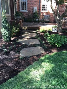 Bluestone stepping stones create path through shade perennial bed.  Connects bluestone terrace to lawn