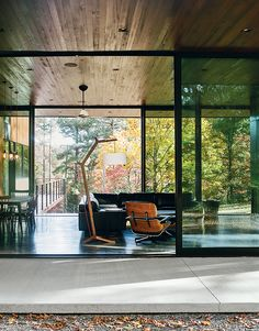 In the living room are a sectional by American Leather for Room & Board, an Eames lounge chair and ottoman, and a custom floor lamp and coffee table by Jeremy Clark and Ed Haynes.