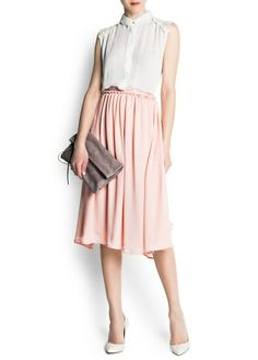 I was browsing through Mango's sale section on their site today and stumbled upon one of my latest obsessions: full, ladylike midi skirts. These are reminiscent of the days when women were mysterious and proper and had an air of feminine mystique. I'm so happy to see them on trend once again because they create a stunning silhouette for any body type. They also can be worn in the office or out to lunch, versatility is the essence of this skirt. What's better, it's on sale!