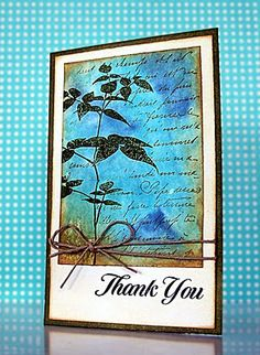 By Jill Foster. Inked acrylic block with Distress Ink (broken china, faded jeans, brushed corduroy), spritzed the block, & pressed it onto white cardstock. Then stamped text in brushed corduroy, removing some ink from stamp with baby wipe before stamping. Stamped plant with forest moss Distress Ink.