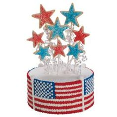 Covered With Glory buttercream cake. Show your true colors! Create a flag-waving cake topped with a bottle-rocket display of sparkling cookies shaped by Stars Nesting Metal Cutters.