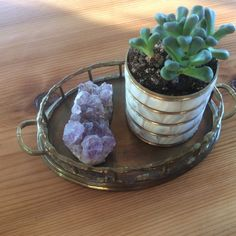 I have a few brass trays around that I use for different things - personally I like them a bit tarnished rather than super shiny. This little guy sits in a windowsill holding an amethyst cluster and a wee succulent that I planted in an old pencil cup. Small Tray, Large Tray, Moroccan Pouf, Moroccan Style, Serving Trays With Handles, Pencil Cup, Metal Trays, Brass Handles, Leaf Design