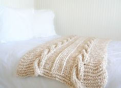 "Putting my ""quick and easy"" mantra aside, check out this chunky cable knit blanket that I just finished!  Okay, in reality, it actually is very quick and easy for a blanket.  Have you seen some of the beautiful chunky cable knit blankets out in stores and online? I can't believe how expensive some of them are. My hubby might have fallen over if..."