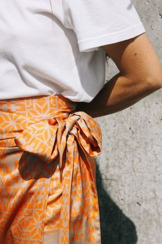 ad26c6f710c2 Jaspre shiny wrap midi skirt orange geometric tan print PIPE AND ROW  www.pipeandrow.