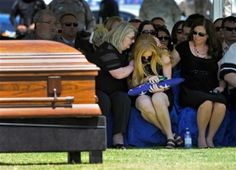 Image: Andrea Soldo, center, is consoled by family members after receiving a flag during the funeral services for her husband, Las Vegas pol.