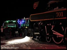 With classic T&NO steamer 701 in the foreground, the 2014 Ontario Northland Christmas Train arrives to an adoring crowd at Englehart December 5th. Tonight (December 8th) the Christmas Train will be rolling into Iroquois Falls, Ontario at 6 pm at the railway crossing by Earl Porter Bowling Lanes!