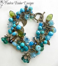 Blue flowers. Stone, Czech glass, crystals, chain and bronze metal bracelet and earrings set.