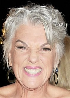 A short haircut with some waves -- like Tyne Daly has -- is pretty and flattering to mature features.