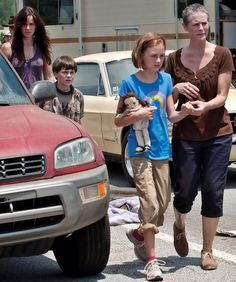 The Walking Dead Laurie and son Carl. Carol and her daughter Sophia her husband Ed used to beat her.