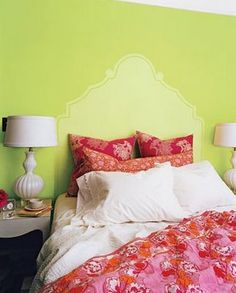 This headboard was painted on the wall using a stencil and contrasting garden-fresh green paint colors.