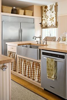 Traditional Home with Eco-friendly cabinet curtains.  Help be a trend setter and use this lovely concept when you remodel your kitchen.