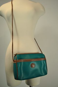 Liz Claiborne purse;  fourth grade...what did i need with a purse?  But i HAD to have one! ;)