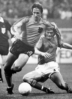 FILE – In This June 19, 1974 file photo, Netherlands Johan Cruyff, left, dodges the tackle from Sweden's Kent Karlsson during a World Cup soccer match in ...