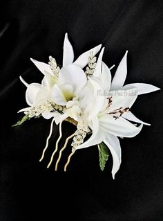 This Defines Beautiful Tropical Bridal Headpiece. An exceptional custom wedding headpiece created with Real Touch flowers including Bird of Paradise, white Tahitian lily, orchid, Plumeria, and crystal sprays.