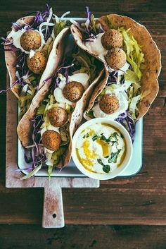 Chickpea and quinoa falafels, with veggies and a yogurt lemon zest and mint sauce. These look super filling and nutritious. Falafels are one of the best ways to get a really satisfying vegan meal that's also portable and filled with vegan protein!