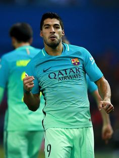 Luis Suarez of FC Barcelona celebrates scoring their opening goal during the Copa del Rey semi-final first leg match between Club Atletico de Madrid and FC Barcelona at Estadio Vicente Calderon on February 1, 2017 in Madrid, Spain.