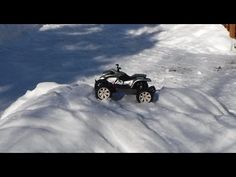 RC ATV takes on the winter rc winter track Honda Sportrax 400EX