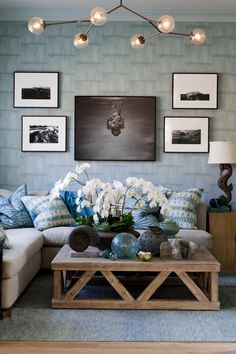 Layered blues, modern light fixture, wood coffee table.