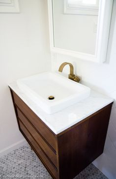 If we can't find a suitable one-piece vanity top — two shallower sinks will work.