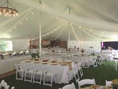 A beautiful DIY vitange country-chic wedding. 40 x 100 pole tent for a wedding of 230 guests with string drop lights added to give that vintage country feel to your wedding tent. 844-Tent Pro