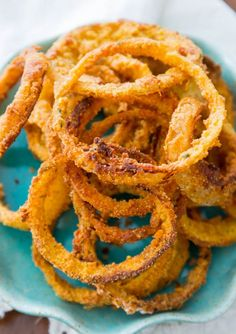 Ingredients: Canola oil spray 4 cups baked potato chips 1/2 tsp. cayenne pepper 1 cup low-fat buttermilk 1/2 cup plus 2 Tbs. all-purpose flour 1/2 tsp. salt, plus more to taste 1/4 tsp. freshly ground black pepper 1 to 2 large Vidalia onions, peeled Directions: Preheat the oven to 450°F. Coat a baking sheet lightly…
