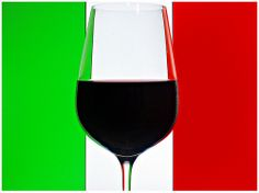 Italian wine in front of the Italian flag. Amarone