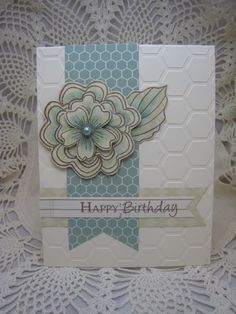handmade card: Happy Birthday ... multi-layered flower stamped three times on patterned paper, colored , cut out and layered to be the focal point ... hexagone embossed texture on the card base ... lovely card!! ... Hero Arts flower ...