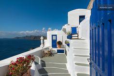 Imagine reading Zorba the Greek in this sea blue Grecian rental!