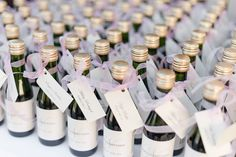 Want a creative idea to let you guest know where to sit as well as a way to say thank you for coming? Janelle and Matt had a great idea! Attach a label with your guest name and their table number to a mini champagne bottle! You can have your guests save the bottles until your first toast or let it be their first beverage on their way to their table.