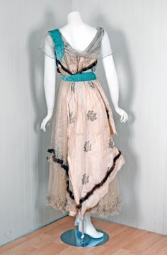 1912 House of Worth Haute Couture Metallic Ivory-Silk Gown   From a collection of rare vintage evening dresses at http://www.1stdibs.com/fashion/clothing/evening-dresses/