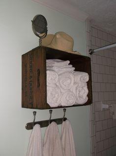 Old apple crate, turned towel shelf