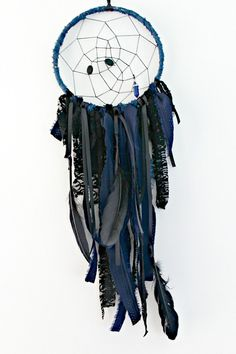 Black and Navy Dream Catcher with Lapis Lazuli Stone  Measures 7 inches across hoop by 26 inches long (including ribbon hanger).  This dream