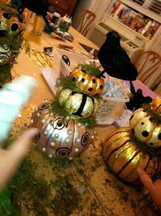 Honey Lamb and I: Painted Farm Halloween Pumpkins. Love the raven/crow topper. http://honeylambandi.blogspot.com/2011/10/painted-farm-pumpkins-we-had-so-much.html