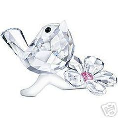 Swarovski Baby Bird - Archived Data - Swarovski Crystal Baby Bird in faceted clear crystal with white opal crystal beak and jet crystal eyes. The flower is. Swarovski Ornaments, Swarovski Crystal Figurines, Swarovski Crystals, Glass Figurines, Collectible Figurines, Cut Glass, Glass Art, Miraculous Ladybug Oc, All Things Crystal