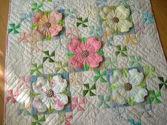 Dogwood's flower quilt, made by all hand stitching