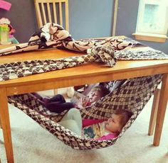 Chair for toddler. Super fun fort idea for kids. Under table swing for toddler. Reading nook for toddler. Cute, easy and free! Simply secure a blanket to your dining table and climb in! Toddler Fun, Toddler Activities, Fun Activities, Indoor Activities For Kids, Toddler Toys, Diy For Kids, Cool Kids, Crafts For Kids, Diy Toys