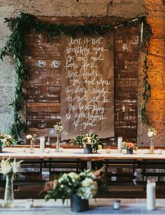 Kraft paper scroll with a calligraphy quote / http://www.deerpearlflowers.com/industrial-wedding-ceremony-decor-ideas/