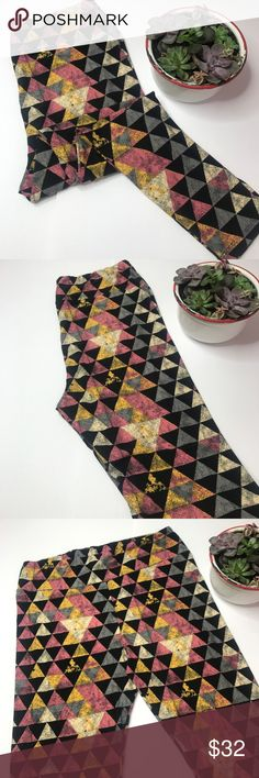 NWT LuLaRoe TC Leggings NWT TC Leggings. These adorable leggings have a cute geometric triangle pattern with cream, gold, black, blue and pink. This pattern is gorgeous and would mix with so many colors. LuLaRoe Pants Leggings