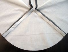 Reinforcing pencil skirt seam and setting in a godet