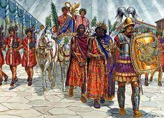Trionfo. Il generale trionfatore indossa la toga ricamata e sul capo gli posano la corona d'alloro d'oro. Davanti sfilano i prigionieri (captivi), ai lati i littori portano i fasci.