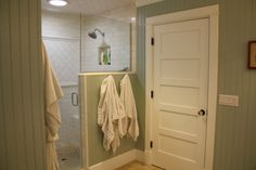 walk in shower idea again, but with a half solid wall to hang towels